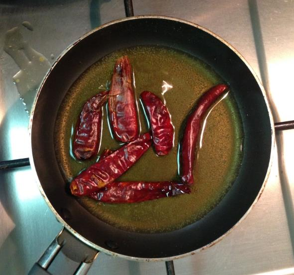Dry chillis in the pan with ghee